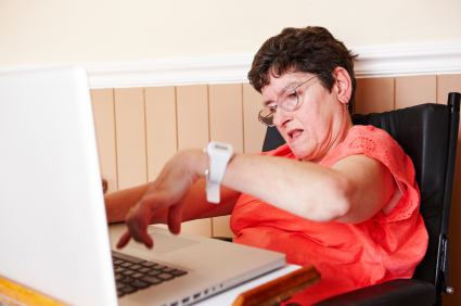 disabled woman working on laptop in wheelchair